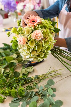 florist arranging beautiful bouquet of flowers