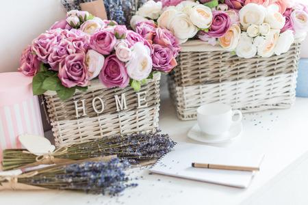 blank notebook with pen and beautiful flowers in wicker baskets at flower shop Zdjęcie Seryjne