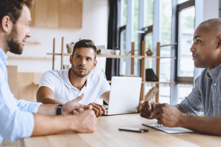 business people discussing business strategy while working in office
