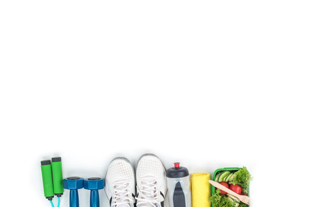dumbbells, skipping rope, sports shoes, bottle of water and vegetable salad isolated on white