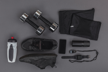 flat lay with sportswear, fitness equipment and gadgets 版權商用圖片