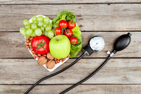 fresh various vegetables, fruits and blood pressure gauge on wooden surface, healthy eating concept Reklamní fotografie
