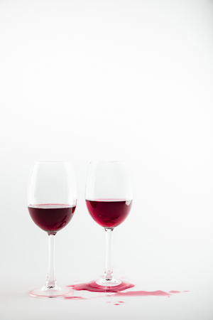 close-up view of wineglasses with red wine and wine spilled Imagens - 84971980