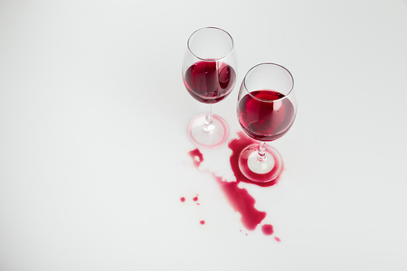red wine in glasses and spilled out isolated on white Imagens - 84971981