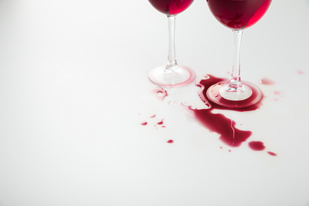 close-up view of wineglasses with red wine and wine spilled
