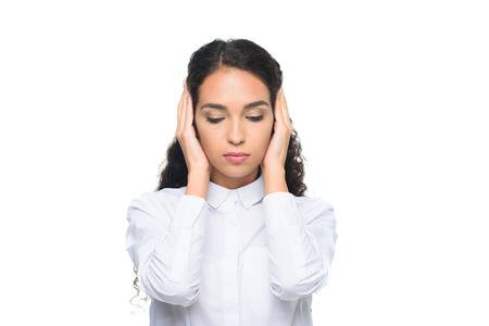 attractive businesswoman in white shirt with closed eyes closing ears with hands