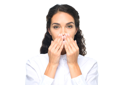 beautiful brunette businesswoman in white shirt closing mouth with hands Stock Photo - 85188426