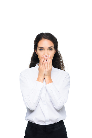 beautiful brunette businesswoman in white shirt closing mouth with hands Stock Photo - 85188431