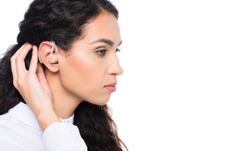 attractive brunette woman with hearing aid