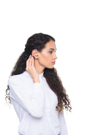 serious attractive brunette woman with hearing aid