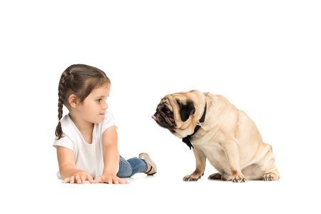 little happy adorable girl with pug dog Stock Photo