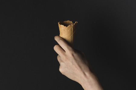 hand holding wafer cone