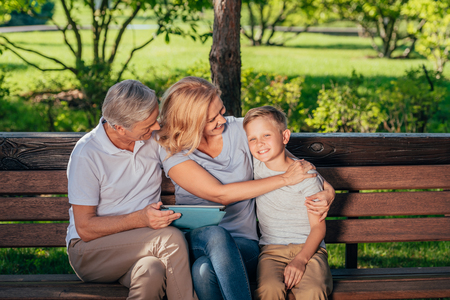 family with digital tablet Standard-Bild
