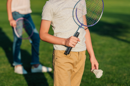 child with badminton equipment Imagens