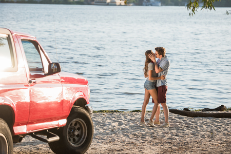 young couple kissing on beach Reklamní fotografie