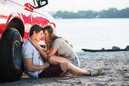 sensual couple near car