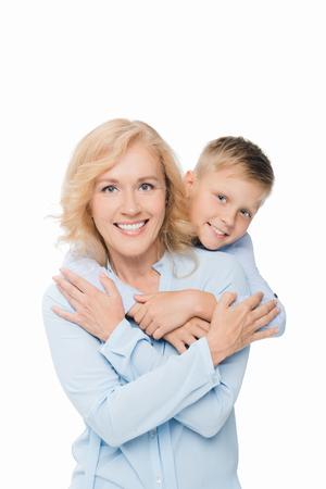 kid hugging grandmother Standard-Bild