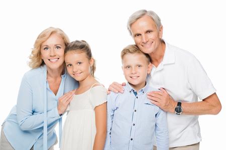 grandparents with grandchildren embracing