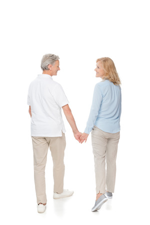 mature couple holding hands Stock Photo