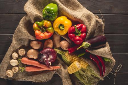 fresh picked vegetables on sacking