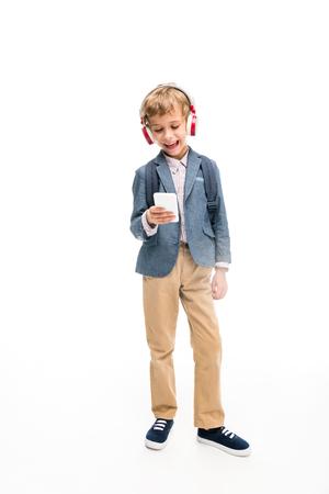 schoolboy using headphones and smartphone Stock Photo