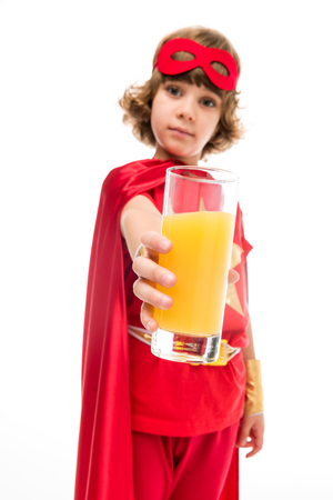 superhero boy with orange juice Stock Photo