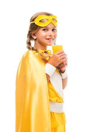 superhero girl drinking orange juice