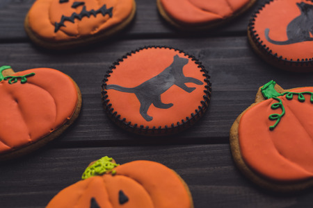 composition of homemade halloween cookies on black table