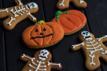 composition of pumpkins and skeletons halloween cookies