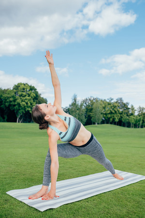 caucasian woman practicing yoga pose