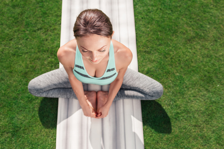 relaxed woman sitting in yoga pose