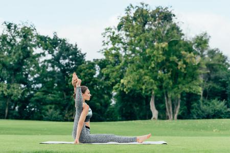 young woman performing yoga pose 版權商用圖片