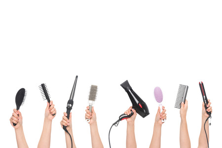 hairdryer: hands holding hairdressing tools