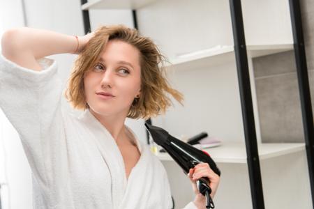 woman drying hair 版權商用圖片