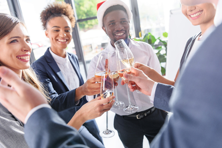colleagues drinking champagne in office Stock Photo