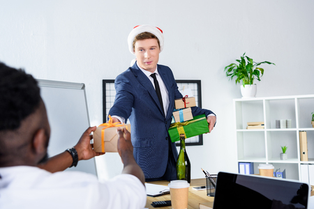 businessman presenting gift to colleague Stock Photo