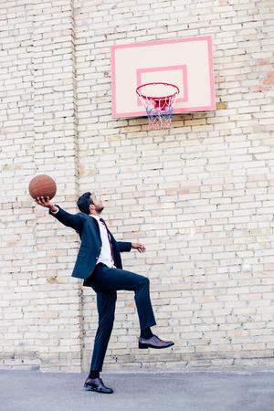 businessman playing basketball