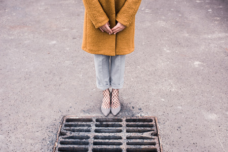 woman in stylish shoes standing on road Stock Photo