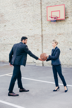 business colleagues with basketball ball Stok Fotoğraf