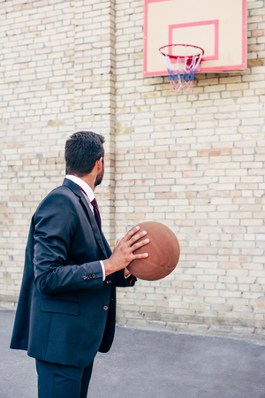 athletic wear: businessman with basketball ball Stock Photo