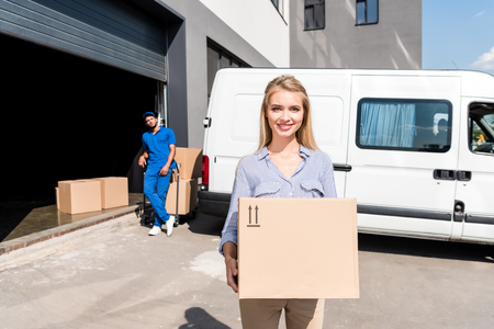 woman with delivered package Stock Photo
