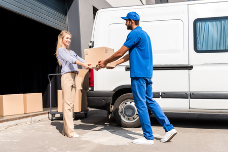 delivery service: courier giving package to woman
