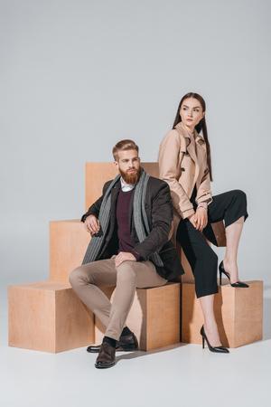 stylish couple on wooden blocks Stock fotó