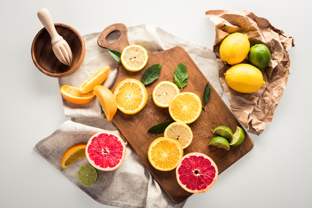 citrus fruits on cutting board Stock Photo