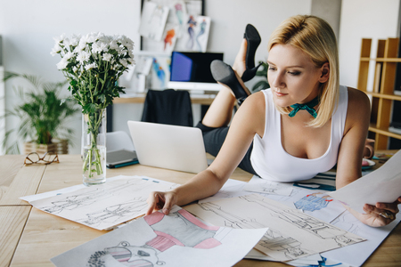 young fashion designer with sketches Фото со стока