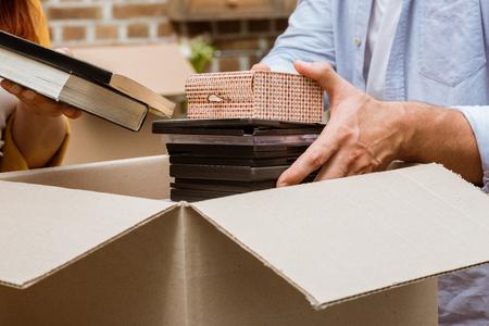 couple unpacking box at home