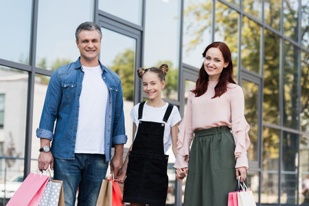 family with shooping bags