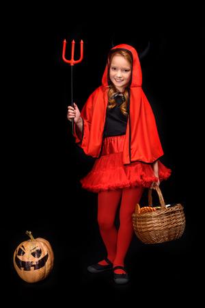 child in halloween costume of devil