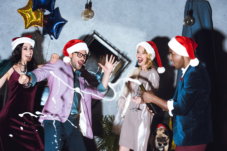 winter fashion: friends celebrating christmas Stock Photo