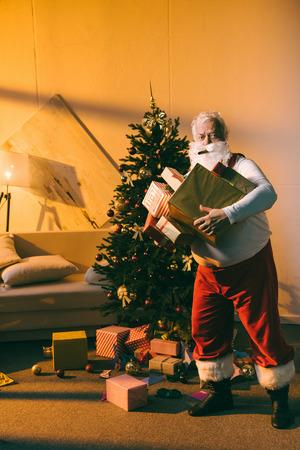 bad santa with gifts and cigar Stock Photo